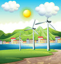 Three windmills across the village illustration of Stock Images