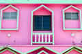 Three window balance and balconyof an pink house detail Royalty Free Stock Photography