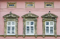 Three windows in an old house on the facade of building lvov ukraine Royalty Free Stock Photos