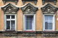 Three windows in an old house wroclaw poland Royalty Free Stock Photo