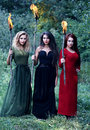 Three witches with with torches Royalty Free Stock Photo