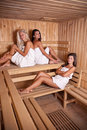 Three women enjoying a hot sauna Royalty Free Stock Image
