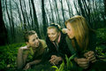 Three women in forest clearing Stock Photo