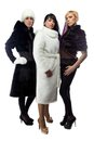Three women in fur coats, full length Royalty Free Stock Photo