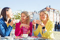 Three women having a fun conversation while coffee break Stock Photography