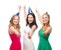 Three women wearing hats and showing thumbs up celebration friends bachelorette party birthday concept smiling blue Royalty Free Stock Images