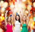Three women wearing hats and showing thumbs up celebration friends bachelorette party birthday concept smiling blue Stock Photo