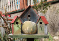 Three wooden bird houses