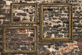 Three wooden frames over ruined brick wall Royalty Free Stock Photography