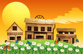 Three wooden houses with flowers illustration of the Stock Image