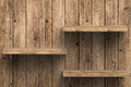 Three wooden shelves on wall Royalty Free Stock Photo