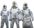 Three workers in protective clothing Royalty Free Stock Photo
