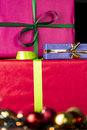 Three wrapped gifts, bowknots, spheres and glitters Royalty Free Stock Photo