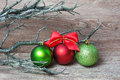 Three xmas balls on wood Stock Images