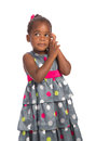 Three year old african american girl holding cellphone years adorable talking on isolated white background Royalty Free Stock Photography
