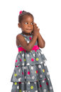 Three year old african american girl holding cellphone years adorable talking on isolated white background Stock Photos
