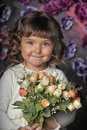 Girl with a bouquet of roses Royalty Free Stock Photo