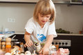 Three years old child cooking happy soap in kitchen Stock Photography