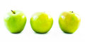 Three yellow and green apples lined up next to each other on a white background Royalty Free Stock Photo