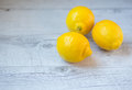 Three yellow lemons on table Royalty Free Stock Images