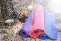 Three yoga mats on the sandy beach of the forest, situated near Royalty Free Stock Photo