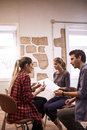 Three young creative business people sharing Royalty Free Stock Photo