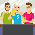 Three young friends watching sports game Royalty Free Stock Photo