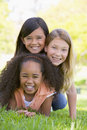 Three young girl friends piled up Stock Image