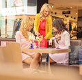 Three young girlfriends at the short break cheerful Royalty Free Stock Images
