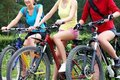 Three  young girls on bicycle Stock Photo