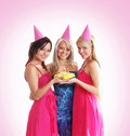 Three young girls are celebrate a birthday party