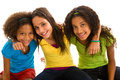 Three young girls hugging multi ethnic group of female friends embracing Royalty Free Stock Photography