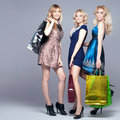 Three young girls shopping. Royalty Free Stock Photo