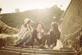 Three young girls sitting on the stairs. Royalty Free Stock Photo
