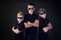 Three young men in black brothers with attitude dressed as fbi detectives Stock Photography