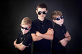 Three young men in black brothers with attitude dressed as fbi detectives Royalty Free Stock Photos