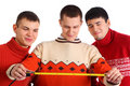 Three young men look on tape measure Royalty Free Stock Photo