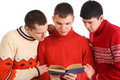 Three young men read book Royalty Free Stock Images