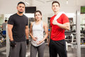 Three young people working out at the gym Royalty Free Stock Photo