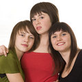 Three young smiling female friends Stock Photos