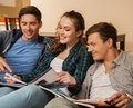Three young students preparing for exams Royalty Free Stock Photo