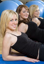 Three Young Woman Aerobic Exercising At A Gym Royalty Free Stock Photo