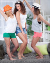 Three young woman dancing at home funny girls having party Stock Image