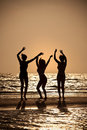 Three Young Women Dancing On Beach At Sunset Royalty Free Stock Photo