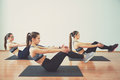 Three young women doing workout together in gym. Fitness and lifestyle concept.