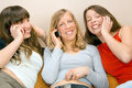 Three Young Women With Phones Stock Photo