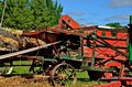 Thresher and wagon of shocks in harvest mode an old threshing machine is the process separating the grain from stalk filling the Stock Image