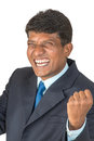 Thrilled indian man a business executive in a suit cheering a win isolated Stock Photo
