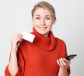 Thrilled young blond woman making a shopping transaction online mobile commerce with copy space credit card for modern convenience Royalty Free Stock Image