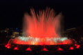 Throngs of people at the colourful light & water fountain show.  Night in Barcelona, Spain, at the magic fountain. Royalty Free Stock Photo